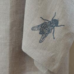 Lniany fartuch z muchą