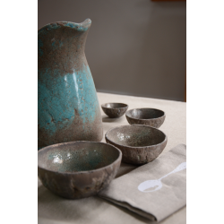 A set of four ceramic raku bowls